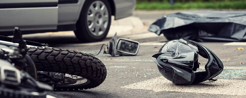 Motorcycle Accident Lawyer St Petersburg | Motorcycle Accident Attorney St Pete | 727.328.9000 - Photo of a motorcycle accident and helmet laying on the ground
